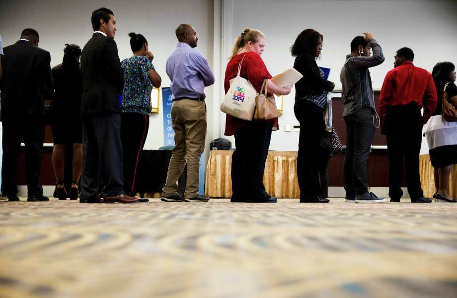 In this June 23, 2014 photo, job seekers wait in line to meet with recruiters during a job fair in Philadelphia. The government issues the July jobs report on Friday, Aug. 1, 2014. (AP Photo/Matt Rourke) ORG XMIT: NYBZ178 Photo: Matt Rourke / AP