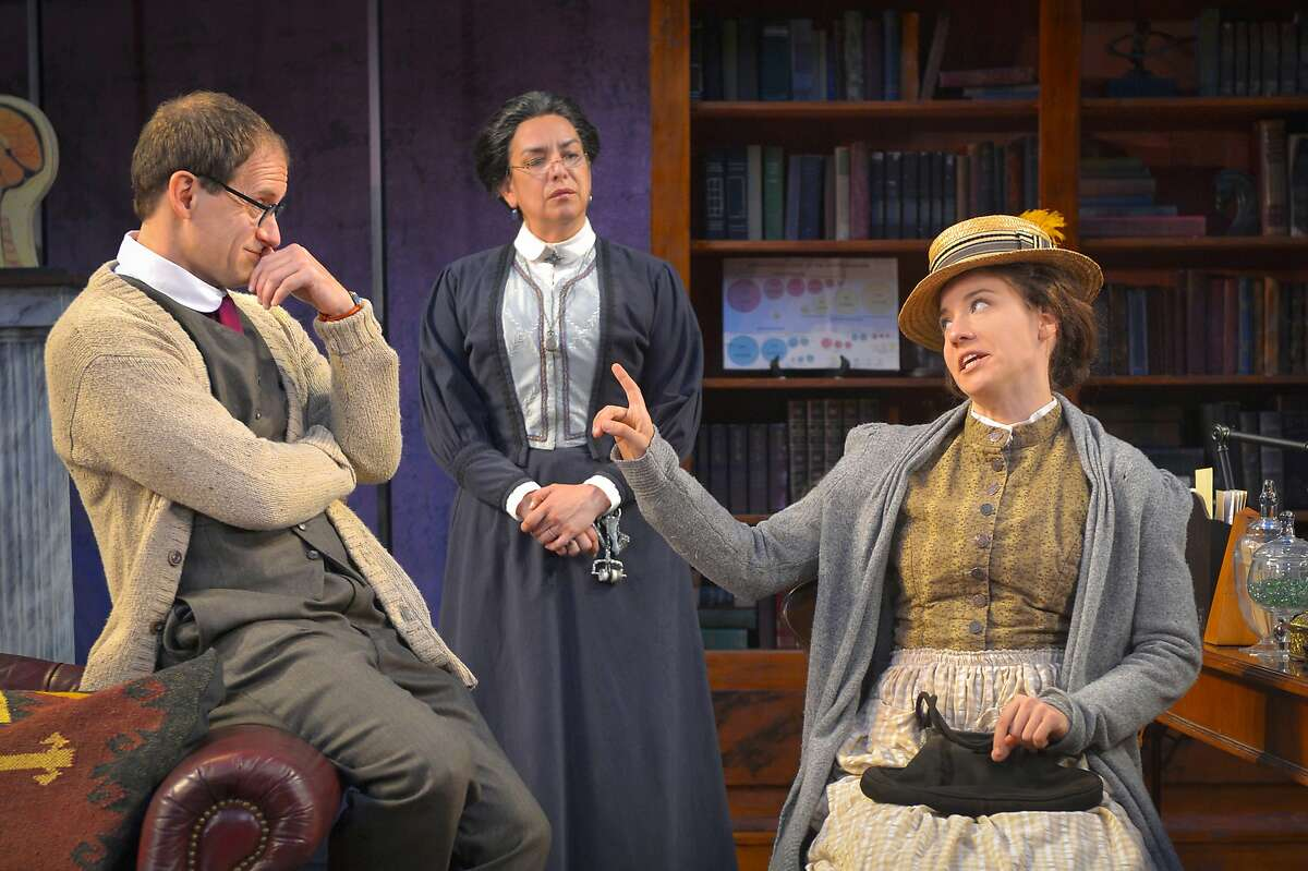 """Eliza Doolittle (Irene Lucio, right) discusses terms with prospective tutor Professor Henry Higgins(Anthony Fusco, left), and his housekeeper Mrs. Pearce (Catherine Castellanos) in Cal Shakes' """"Pygmalion"""""""