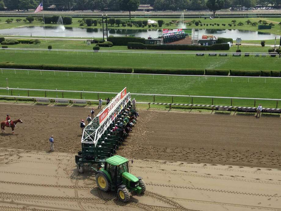 And they're off at Saratoga! Horses break from the starting gate in Friday's first race at Saratoga Race Course. Races that are run at 11/8 miles always start right at the finish line, giving fans the best look at horses coming out of the gate. Oh, in case you were wondering, Friday's first race was won by the No. 8 horse. Royal Posse. —Tim Wilkin