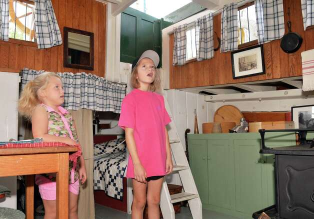 Erica Nelson, 8, left, and Saige Fisher, 9, marvel at the family quarters aboard the Lake Champlain Maritime Museum's Schooner Lois McClure during its visit Friday August 1, 2014, in Mechanicville, NY.  (John Carl D'Annibale / Times Union) Photo: John Carl D'Annibale / 00028007A