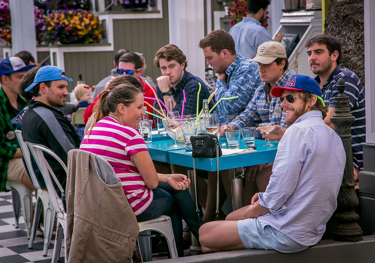 People enjoy the patio at Palm House in San Francisco, Calif. on Wednesday, July 30th, 2014.