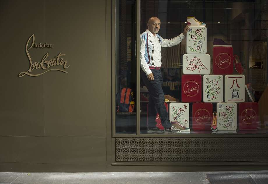Christian Louboutin, designer and founder of Christian Louboutin, is seen in the San Francisco, Calif., store window on Maiden Lane on Monday, July 28, 2014. Photo: Russell Yip, The Chronicle