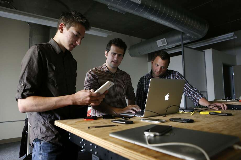 Designer Artur Pokusin (left) and Bolt co-founders Andrew Benton and Chris Goddard work on their app that allows users to call each other for free. Instagram has released a photo messaging service of the same name. Photo: Michael Macor, The Chronicle