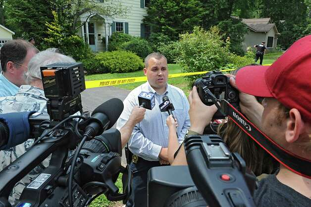 Detective Sergeant Adam Hornick of the Bethlehem Police Department talk to the press as police investigate a body that was found at this 63 Union Ave. home on Friday, Aug. 1, 2014 in Delmar, N.Y. (Lori Van Buren / Times Union) Photo: Lori Van Buren / 00028036A