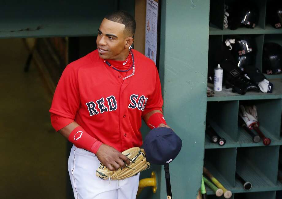 Yoenis Céspedes enters the Fenway Park dugout before the Red Sox played the Yankees, but he didn't get into the game. Photo: Winslow Townson, Associated Press