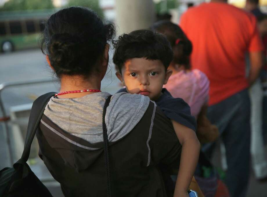 Salvadoran immigrants just released from U.S. Border Patrol detention wait at the Greyhound bus station in McAllen for their journey to Houston. Photo: John Moore / Getty Images / 2014 Getty Images