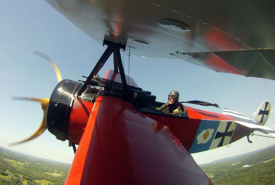 David King pilots a War War I-era Fokker DR-1 reproduction plane during an air show in Rhinebeck, N.Y. Photo: Mike Groll / Associated Press / AP
