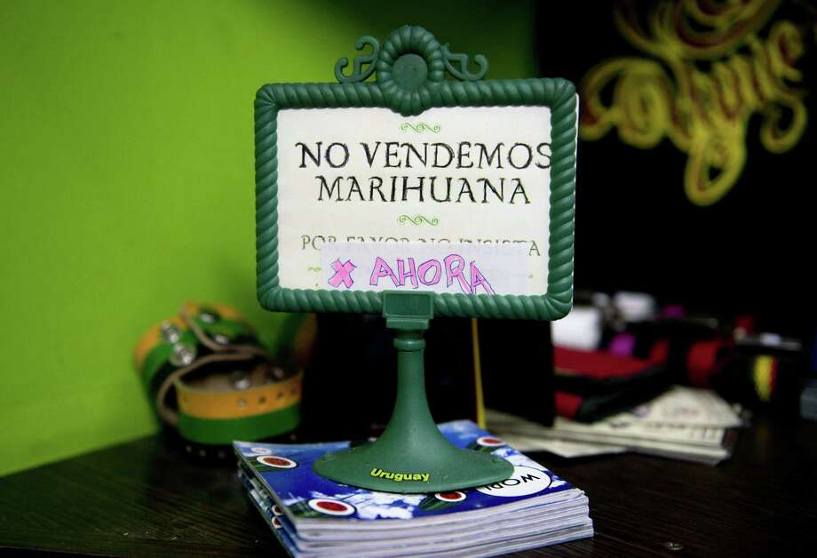 "FILE - This May 6, 2014 file photo shows a sign that reads in Spanish; ""We don't sell pot, yet,"" on display at a head shop in downtown Montevideo, Uruguay. Delays in implementing the plan to create the world's first national, government-regulated marketplace for legal pot , are putting it at risk as polls point to opposition gains in October general elections and disapproval of the project by most Uruguayans. (AP Photo/Matilde Campodonico, File) Photo: Matilde Campodonico, STR / AP"
