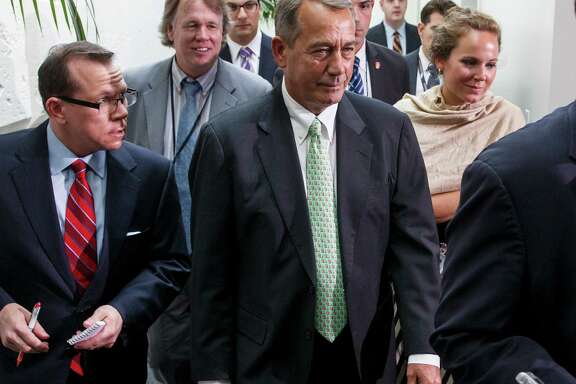 Speaker John Boehner leaves a closed-door meeting of House Republicans on Capitol Hill Friday.