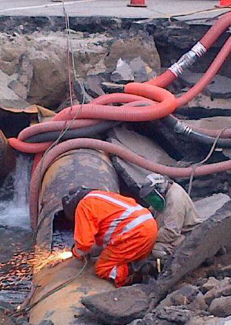 Workmen cut a pipe at the site of the UCLA flood. Photo: L.A. Dept. Of Water And Power / LADWP
