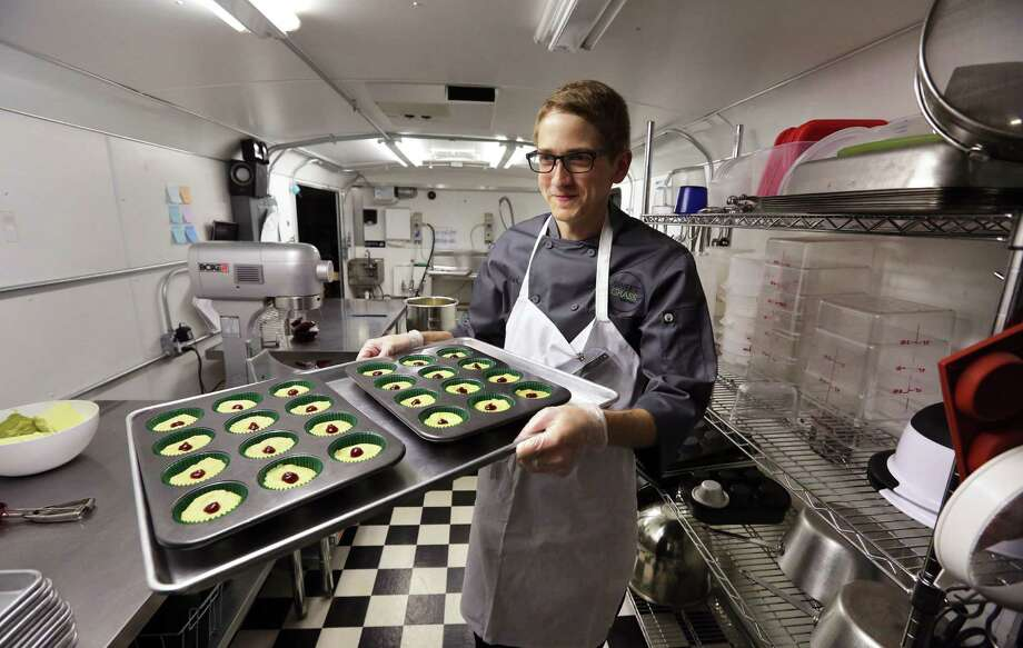 A tray of cannabis-infused peanut butter and jelly cups is ready for baking at Sweet Grass Kitchen, a well-established Denver-based gourmet marijuana edibles bakery. Photo: Brennan Linsley / Associated Press / AP