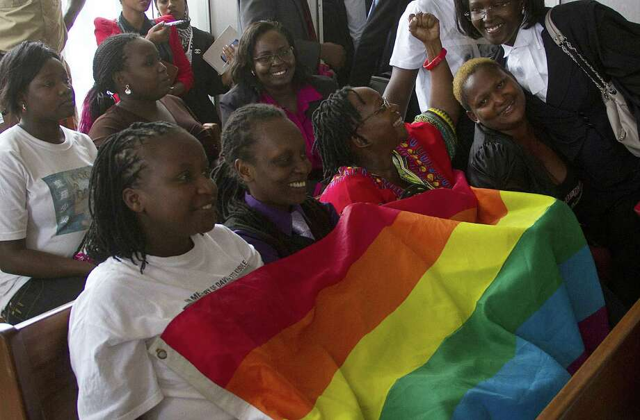 Gay rights activists in Uganda cheer a constitutional court's ruling that overturned the country's Anti-Homosexuality Act. But the judges nullified the law in such a way that Parliament could pass it again. Photo: Isaac Kasamani / Getty Images / AFP