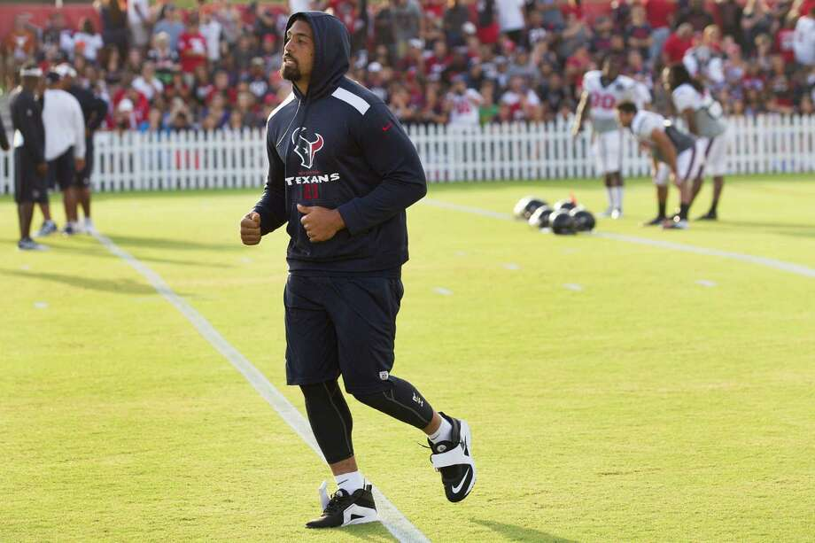 Running back Arian Foster's tender hamstring is keeping him from sustained work at camp. Foster watched Friday after full participation Wednesday Photo: Brett Coomer, Staff / © 2014 Houston Chronicle