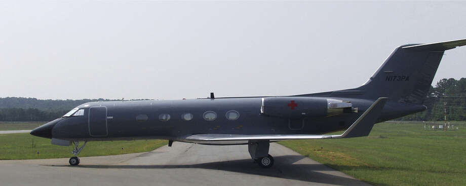 A Gulfstream airplane has been modified to carry a sealed Aeromedical Biological Containment System. Photo: Associated Press / CDC
