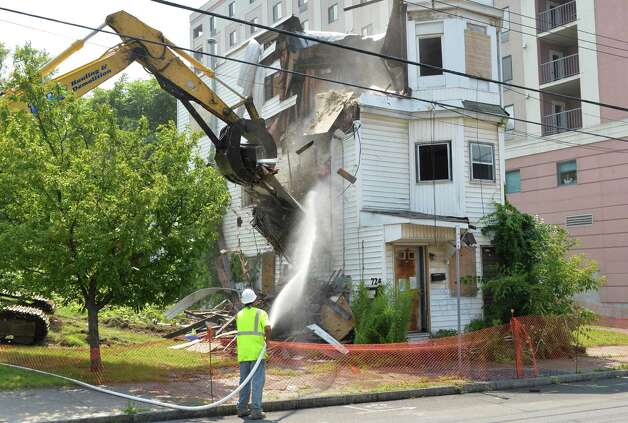 The house at 722 Eastern Avenue is demolished Friday August 1, 2014, in Schenectady, NY. (John Carl D'Annibale / Times Union) Photo: John Carl D'Annibale / 00028032A