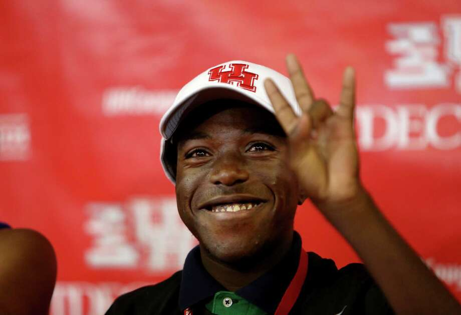 Jacolby Rogers, 15, a freshman at Davis High School who suffers from end-stage renal disease, is all smiles after signing an honorary letter of intent and becoming the final member of the Cougars' 2014 recruiting class. Photo: Gary Coronado, Staff / © 2014 Houston Chronicle