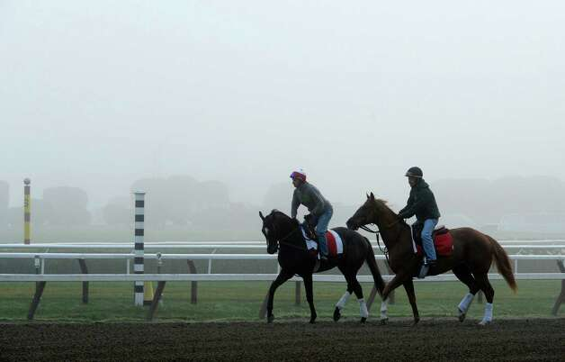 Fog obscures the clubhouse on the main track as horses go out for their morning exercise at the Saratoga Race Course early Friday morning Aug. 1, 2014 in Saratoga Springs, N.Y.    (Skip Dickstein photos Photo: SKIP DICKSTEIN