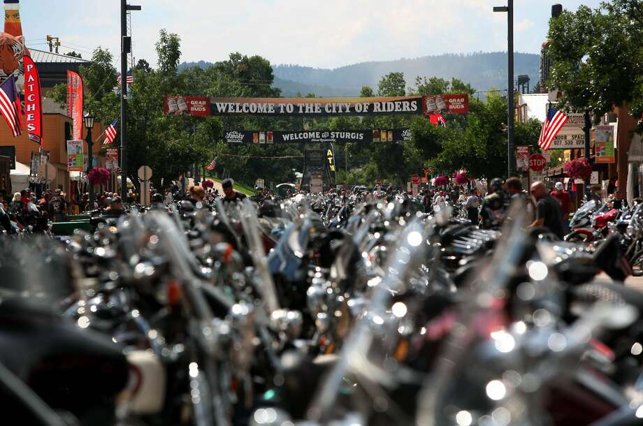 The city streets of Sturgis are lined with motorcycles days before the official kickoff of the 74th Annual Sturgis Motorcycle Rally in Sturgis, S.D, on Friday afternoon, August 1, 2014. Organizers expect attendance at this week's Sturgis Motorcycle Rally to top the estimated 466,000 who made the annual trek last year. (AP Photo/Toby Brusseau) Photo: Toby Brusseau, Associated Press