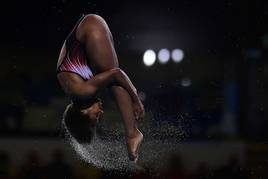 Canada's Jennifer Abel dives during the 1m springboard diving final, at the Royal Commonwealth Pool, during the Commonwealth Games 2014, in Edinburgh, Friday Aug. 1, 2014. (AP Photo/PA, Tim Ireland) UNITED KINGDOM OUT NO SALES NO ARCHIVE Photo: Tim Ireland, Associated Press