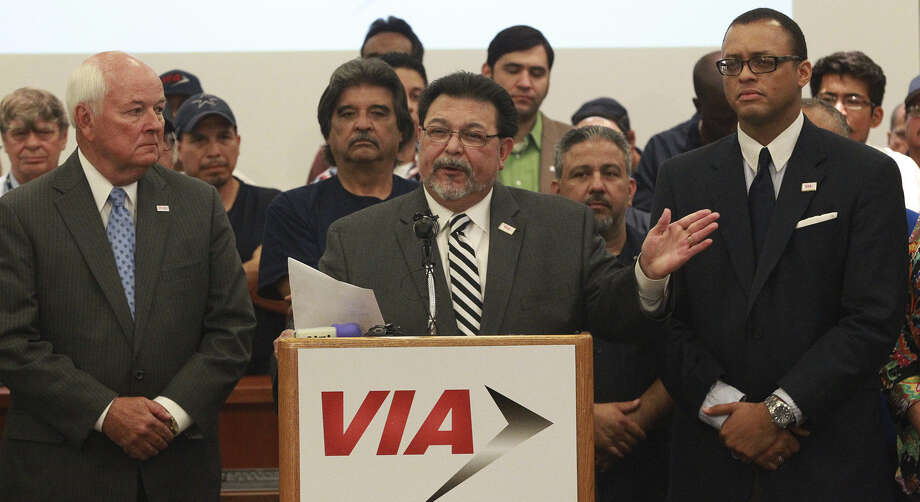 VIA Board Chairman Alex Briseño is flanked by VIA employees and board members as he speaks Friday at VIA headquarters about action to defer the modern streetcar project. The city and county had already pulled back from the project. Photo: John Davenport / San Antonio Express-News / ©San Antonio Express-News/John Davenport