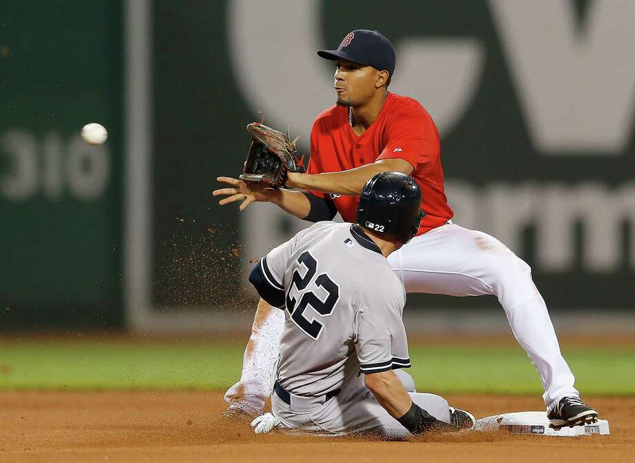 BOSTON, MA - AUGUST 1:  Xander Bogaerts #2 of the Boston Red Sox takes a throw as Jacoby Ellsbury #22 of the New York Yankees steals second base in the sixth inning  at Fenway Park on August 1, 2014 in Boston, Massachusetts. (Photo by Jim Rogash/Getty Images) ORG XMIT: 477587233 Photo: Jim Rogash / 2014 Getty Images