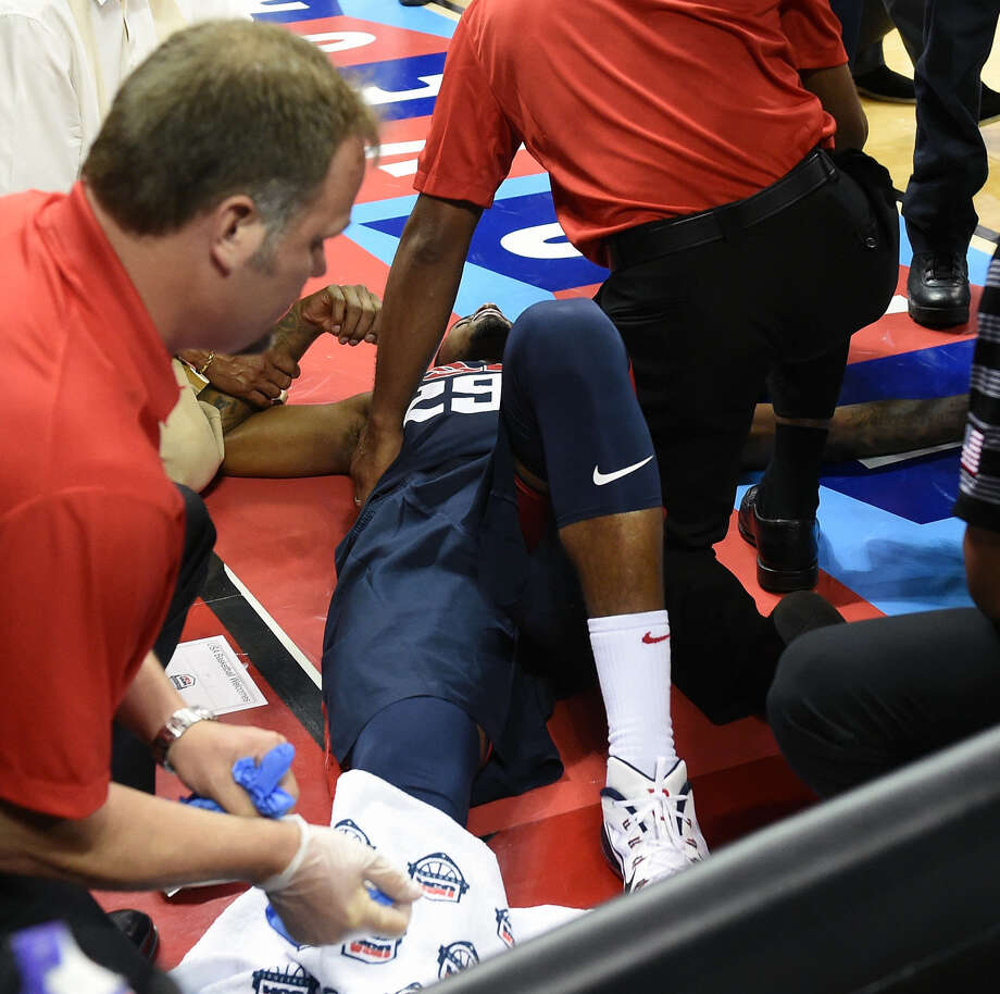 Indiana All-Star Paul George is tended to after significantly injuring his leg in a Team USA scrimmage Friday. Photo: Ethan Miller / Getty Images / 2014 Getty Images
