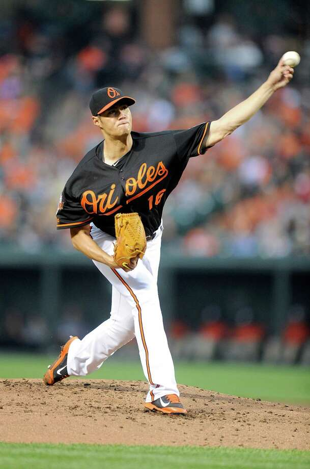 BALTIMORE, MD - AUGUST 01:  Wei-Yin Chen #16 of the Baltimore Orioles pitches in the second inning against the Seattle Mariners at Oriole Park at Camden Yards on August 1, 2014 in Baltimore, Maryland.  (Photo by Greg Fiume/Getty Images) ORG XMIT: 477587235 Photo: Greg Fiume / 2014 Getty Images