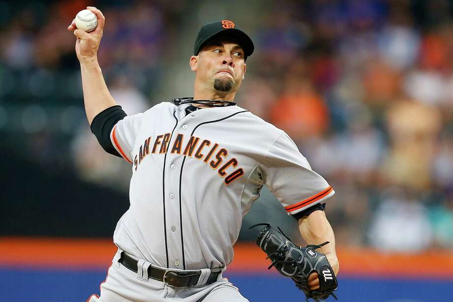 Ryan Vogelsong delivers a pitch in the first inning of his complete-game victory over the Mets. Photo: Mike Stobe / Getty Images / 2014 Getty Images