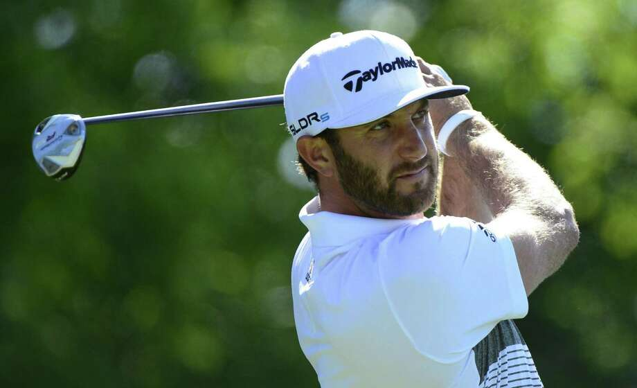 Golf.com reported that Dustin Johnson, who announced Thursday he was taking a leave of absence, was suspended over a positive cocaine test. The PGA Tour said that claim was false. Photo: Paul Chiasson / Associated Press / CP