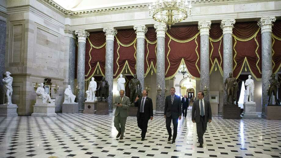 House members walk through Statuary Hall following the vote on the bill that would get tough on undocumented immigrants. Photo: New York Times / NYTNS