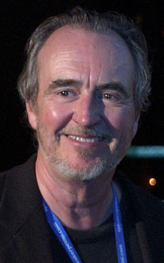 ** FILE ** In a file photo director Wes Craven,arrives at a party  July 28, 2004, at the Via Matta restaurant in Boston.  Wes Craven sued his neighbor Pauly Shore Wednesday June 20, 2007, , alleging that water from the comedian's home seeped down a slope and damaged the director's property. (AP Photo/Lisa Poole) Photo: LISA POOLE / AP