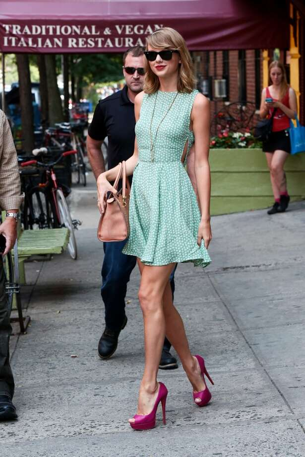 Taylor Swift knows how to do summer style. Here are some of her best looks.  Bold pink heels for a pop of color on July 22, 2014. Photo: Ignat/Bauer-Griffin, GC Images