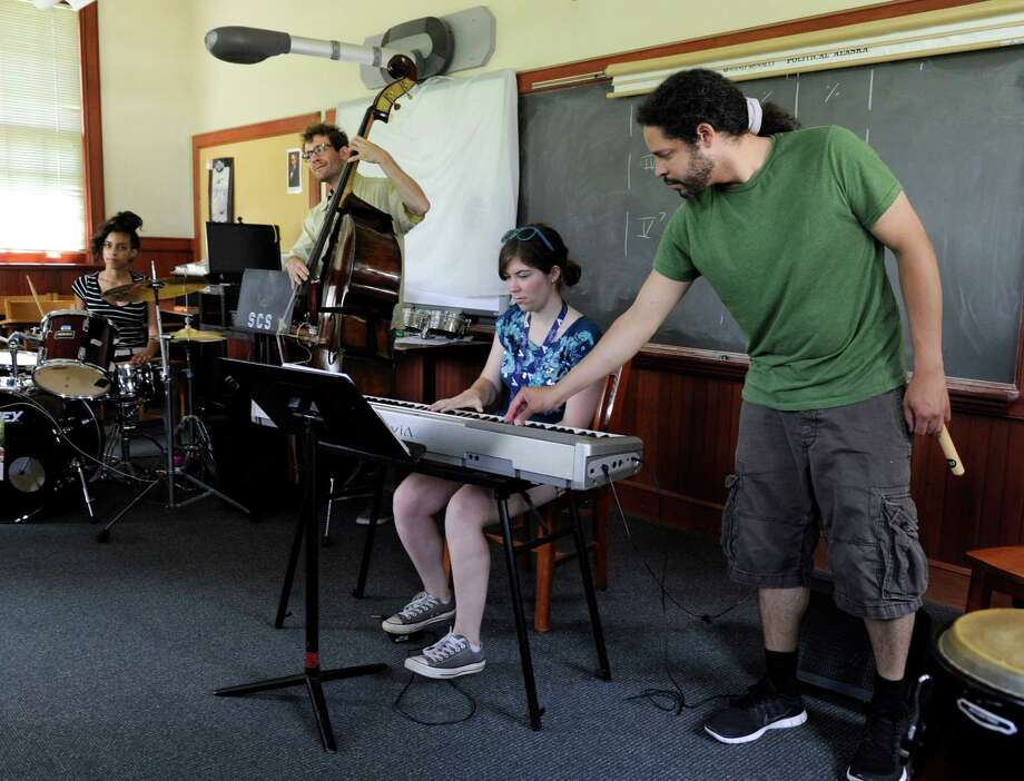 Sofia Imbimbo of Darien, is instructed by Zaccai Curtis, 32, who is teaching a beginners ensemble jazz class Wednesday, July 23, 2014. The Litchfield Jazz Camp, held this year at Canterbury School in New Milford, Conn., runs from July 6 through Aug. 10, 2014. Photo: Carol Kaliff / The News-Times
