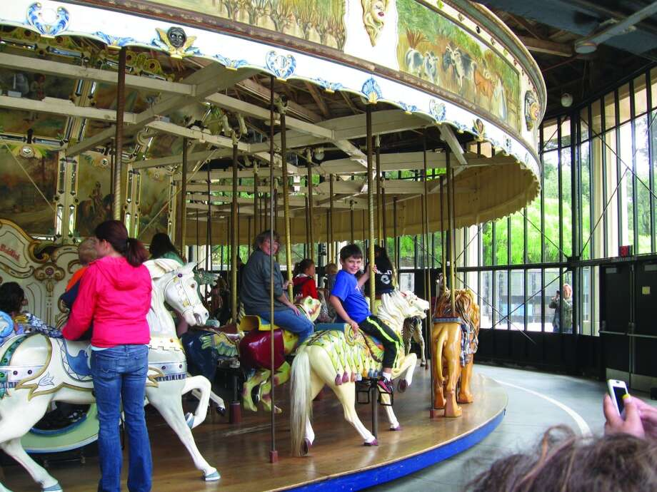 Tim Griffins son Bradley takes a second ride on the Golden Gate Park Carousel, which was once an attraction at the 1939 World's Fair at Treasure Island. Photo: De De Griffin, For The Express-News