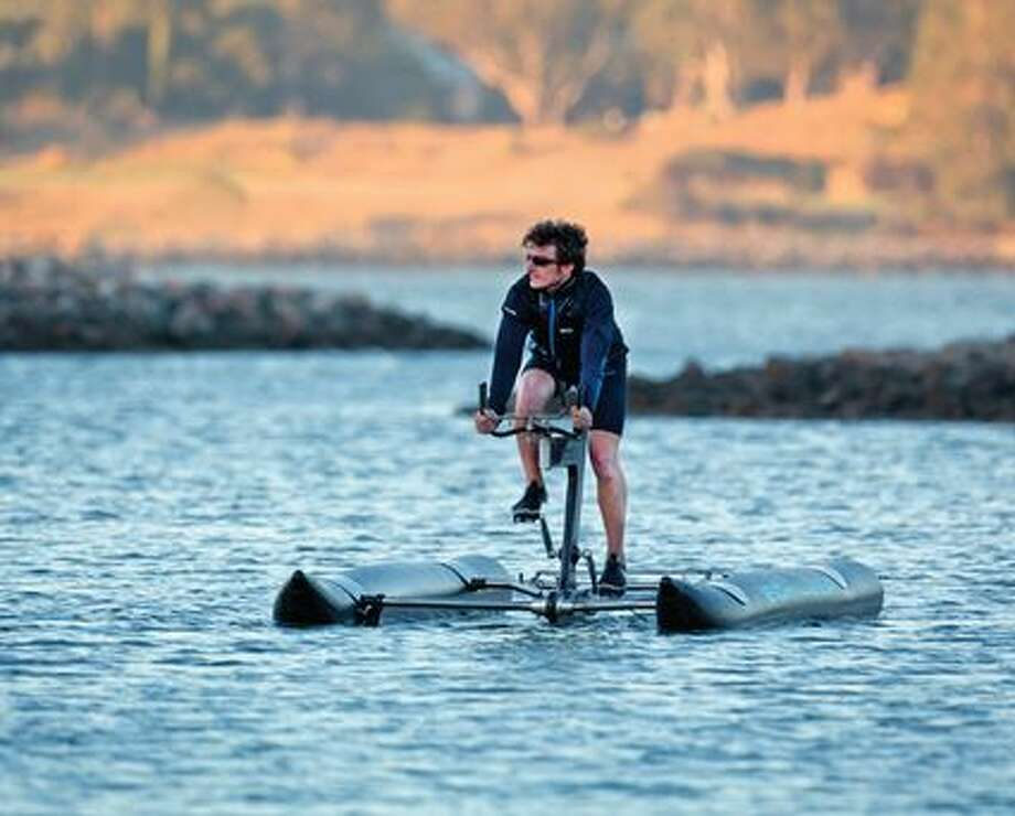 Judah Schiller introduced the X1 water bike at a press conference Friday. The contraption is said to the first of it's kind. Photo: Williams, Kale, Courtesy: Schiller Bikes