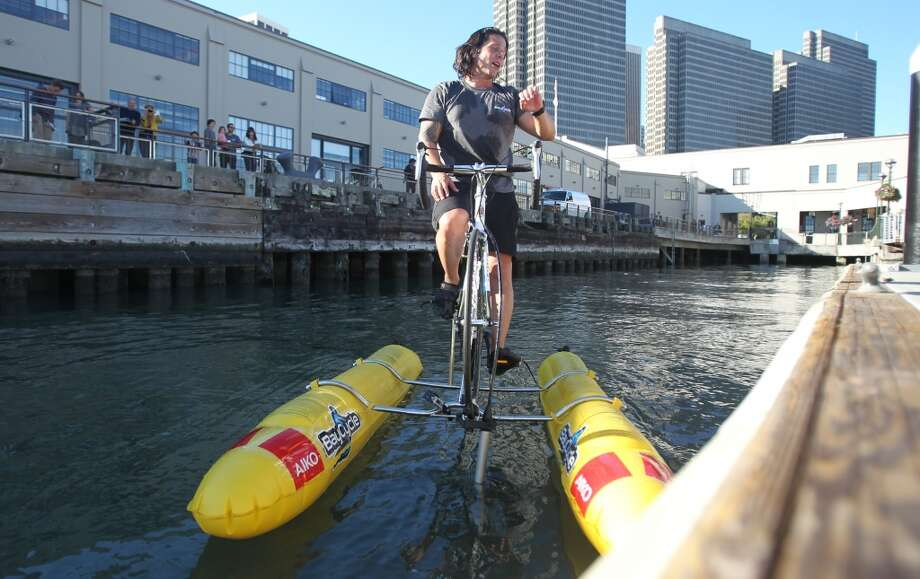 Judah Schiller, Founder of Schiller Bikes, checks his time after making the first crossing of San Francisco Bay on a water bike to promote alternative transportation for cyclists in 2013. On Friday, Schiller unveiled the first commercially available water bike, the X1. Photo: Mathew Sumner, Special To The Chronicle