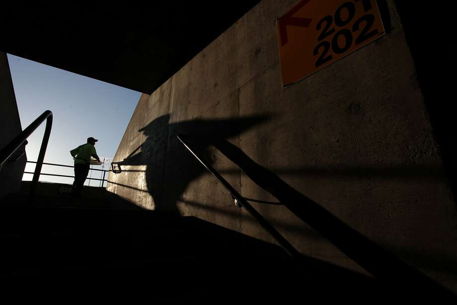 A vendor makes his way through the O.co Coliseum as the Oakland Athletics play the Kansas City Royals on Friday. The A's recently agreed to a 10-year lease. Photo: James Tensuan, The Chronicle