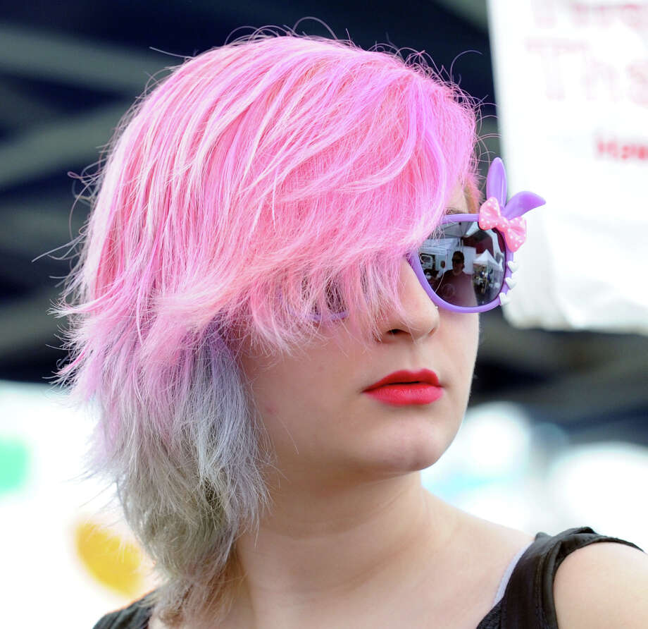 Jennifer Inzitari, 18, of Greenwich, rocks out the pink haircut while shopping with her mother, Mary, in downtown Greenwich, Conn., Saturday morning, Aug. 2, 2014. Photo: Bob Luckey / Greenwich Time