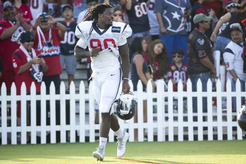 Texans linebacker Jadeveon Clowney jogs onto the field for practice.