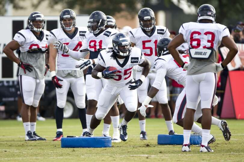 Texans linebacker Jason Ankrah (65) runs a tackling drill.