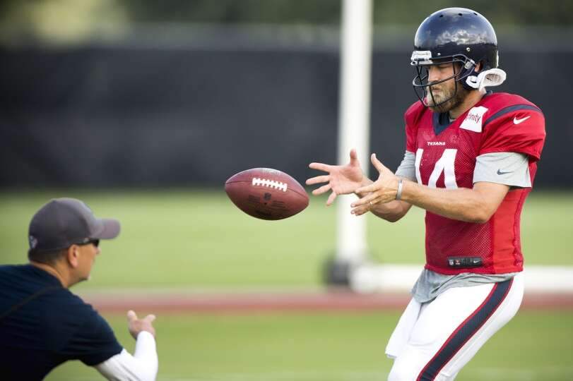 Texans quarterback Ryan Fitzpatrick takes a snap.