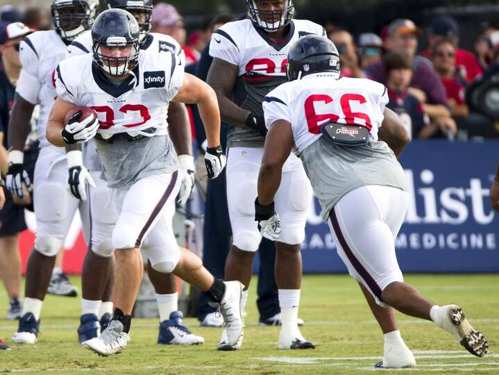 Texans defensive end Jared Crick (93) and nose tackle David Hunter (66) run through a tackling drill