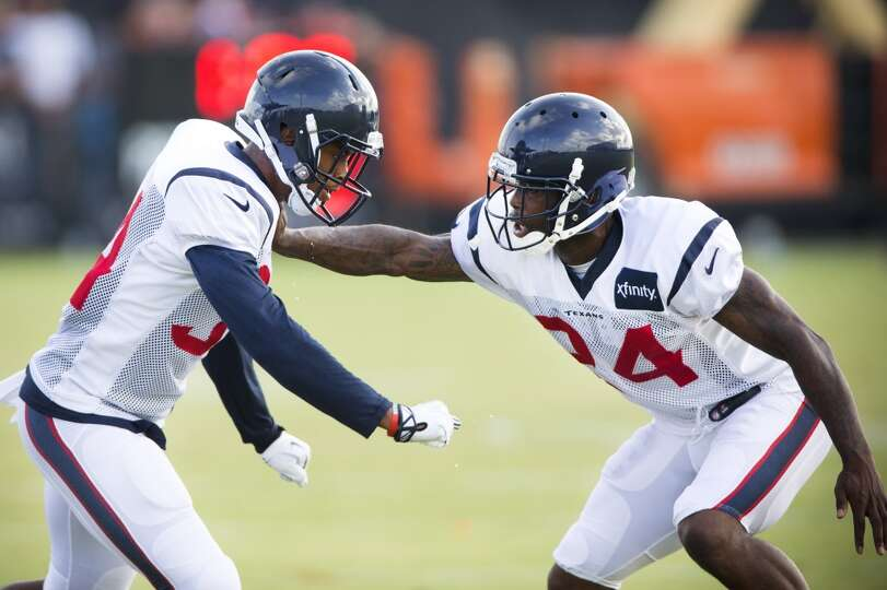 Texans cornerbacks A.J. Bouye (34) and Johnathan Joseph (24) run a pass coverage drill.