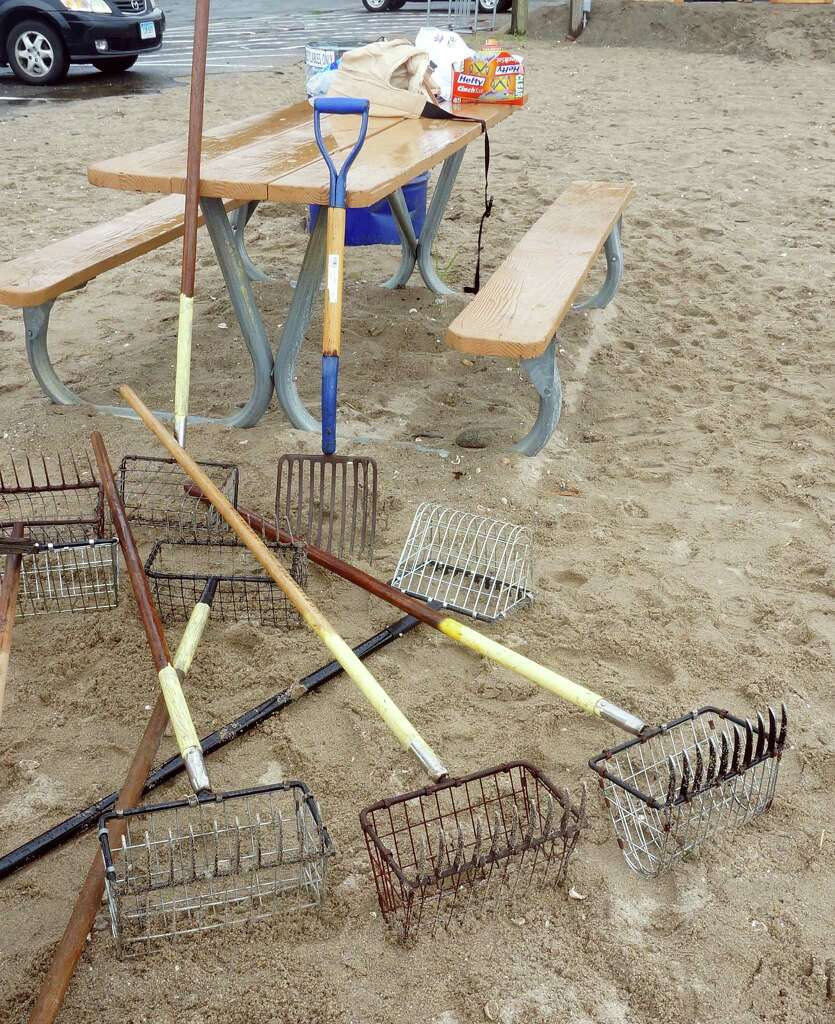 fairfield holds clam clinic connecticut post clam rakes sit ready for novice shellfishers at a clam clinic saturday at sasco beach