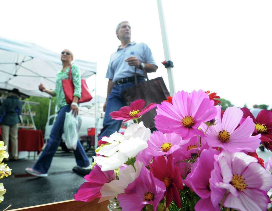 Flowers on display and for sale during the Greenwich Farmers Market in the Horseneck public parking lot across the street from the Boys & Girls Club in Greenwich, Conn., Saturday morning, Aug. 2, 2014. The market is open on Saturdays 9:30am to 1:00pm at the lot and runs until November. Photo: Bob Luckey / Greenwich Time
