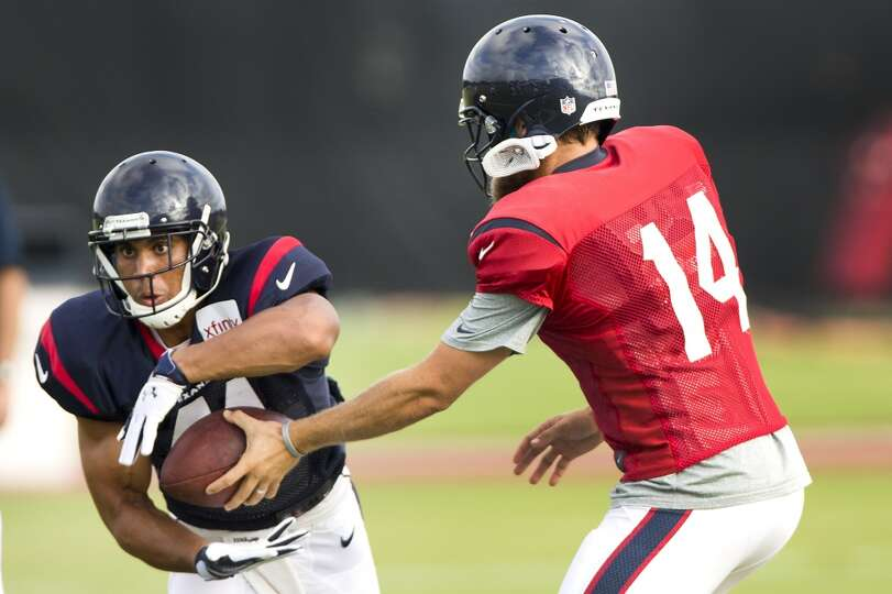 Texans running back Jonathan Grimes (41) takes a handoff from quarterback Ryan Fitzpatrick (14).