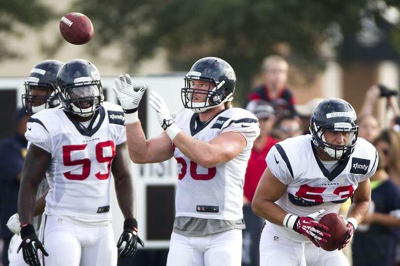 Texans outside linebacker Whitney Mercilus (59), utside linebacker Brooks Reed (58) and inside lineb