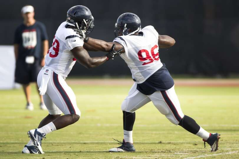 Texans outside linebacker Whitney Mercilus (59) and defensive end Tim Jamison (96) participate in a