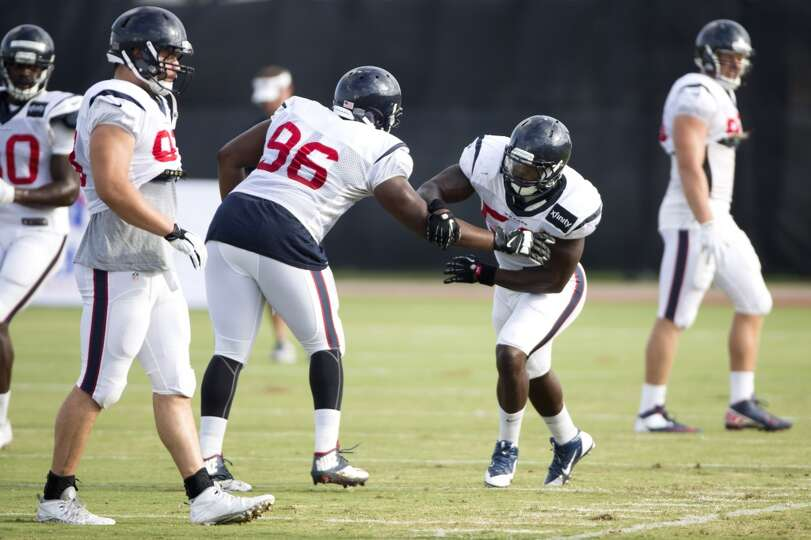 Texans defensive end Tim Jamison (96) and outside linebacker Whitney Mercilus (59) run a pass rush d