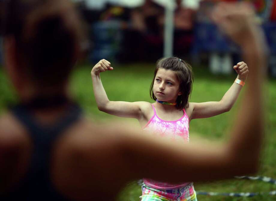 Delaney Hand, 9, of Fairfield, does yoga in the kids corner at the annual Gathering of the Vibes music festival Saturday, Aug. 2, 2014, at Seaside Park in Bridgeport, Conn. Photo: Autumn Driscoll / Connecticut Post freelance